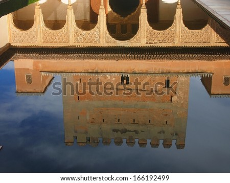 water reflection of the Comares Tower and Patio of the pond at the Court of Mytles, La Alhambra, Granada, Spain - stock photo