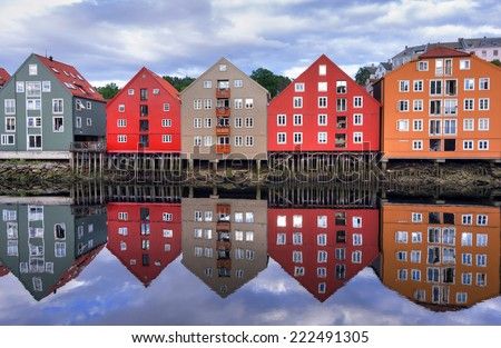 Water reflection of typical Trondheim architecture - stock photo