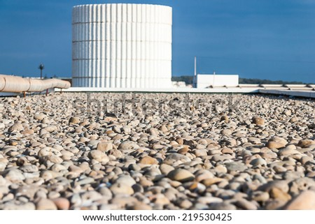 Water reservoir tank and pebbles at foreground - stock photo