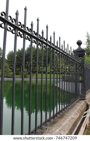 Water reservoir with wrought iron fencing at Mt Tabor. Portland Oregon