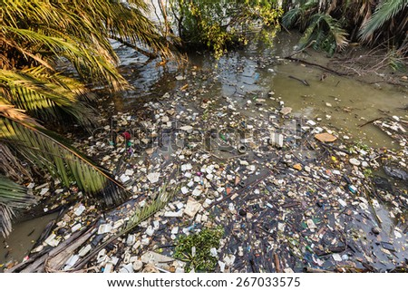Water rubbish pollution with plastic and other floating stuffs in the chao phraya river in Bangkok, Thailand - stock photo