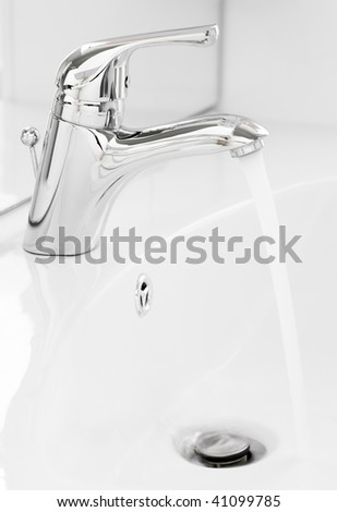 Water running close up in the bathroom - stock photo