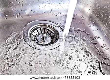 Water running down the drain - stock photo