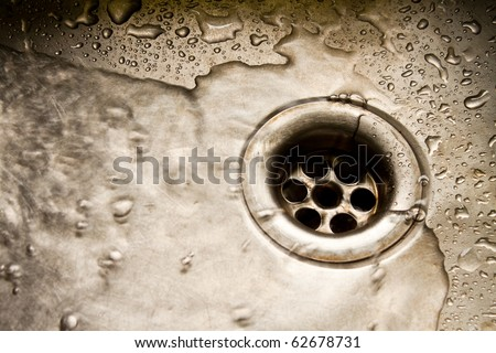 Water running down the drain, deep sinkhole - stock photo