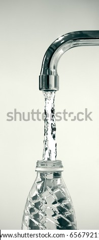 water running from a tap to a reusable plastic bottle on white background