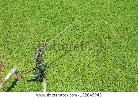Water running from aged faucet - stock photo