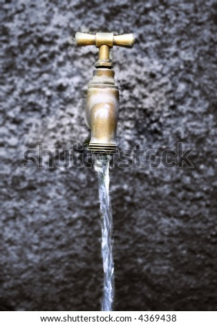 Water running from outdoor tap