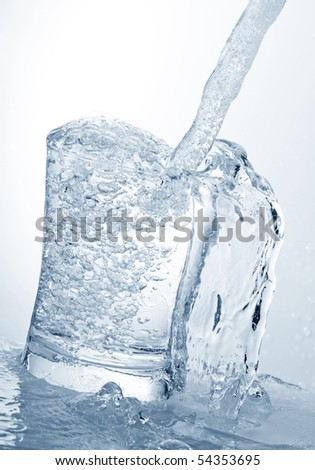 water running into a glass isolated on white - stock photo