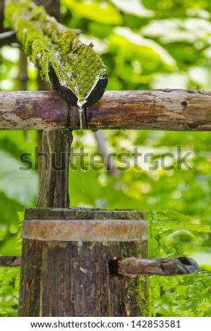 Water running out of outdoor faucet, natural ecology drink water from forest spring source - stock photo