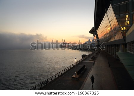 Water's Edge, Vancouver. Vancouver's Convention Center and Canada Place on Burrard Inlet at dawn. British Columbia, Canada.  - stock photo