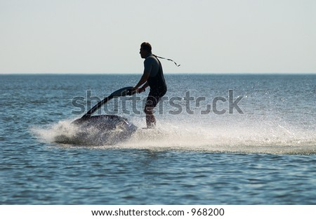 Water Scooter and splashes - stock photo