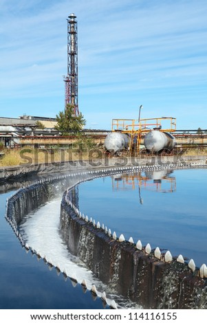 Water settling, purification and recycling on industrial treatment plant - stock photo
