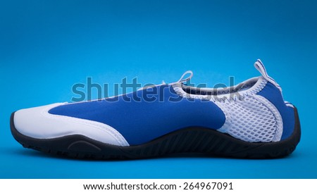 Water shoe on blue background with vignette, side view - stock photo