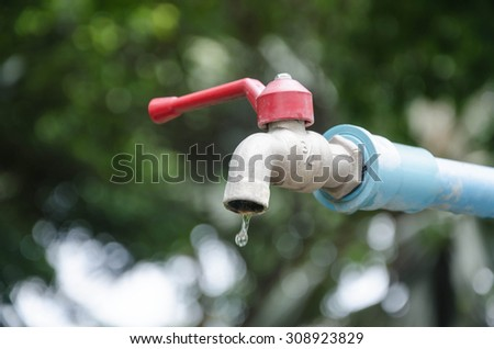 water shortage Old faucet dripping water - stock photo