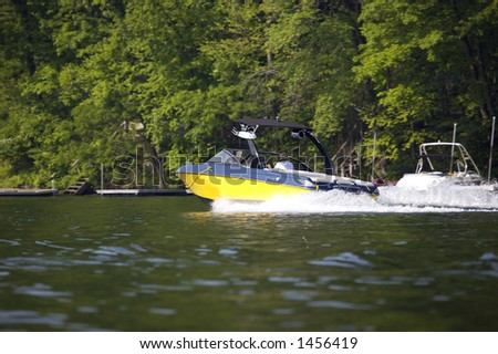 Water Ski or Wakeboard Boat - stock photo
