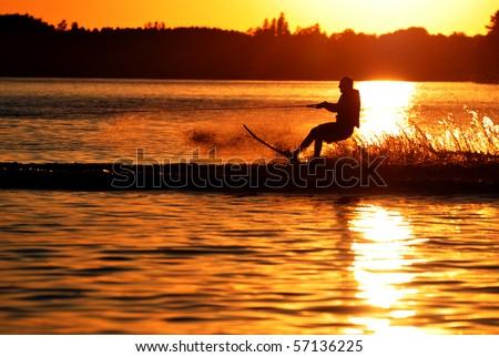 Water Skier Silhouetted by Sunset - stock photo