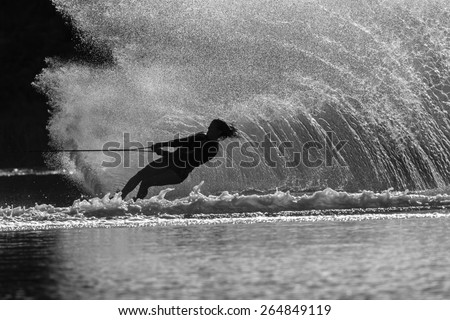 Water Skiing Girl Black White Water skiing girl upright water wall spray wake off ski in vintage black and white - stock photo