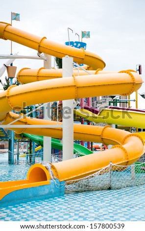 Water slide in a funfair park. - stock photo