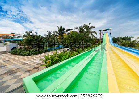 water slides in tropical aqua park.