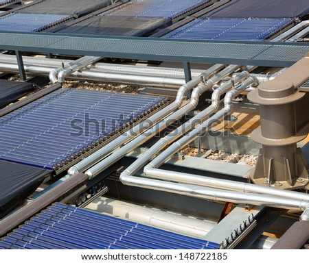 Water solar panels on roof - stock photo