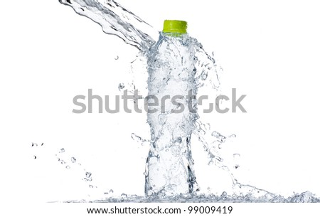 Water splash at bottle with green cap, shallow depth of field - stock photo