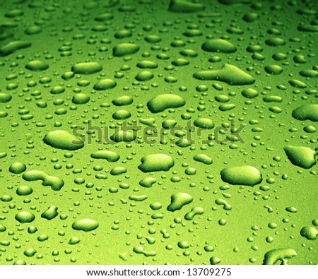 Water Splash Drops on Green Metallic Surface - stock photo