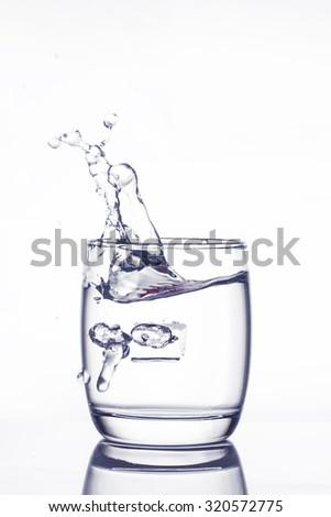 water splash in glass on white background - stock photo