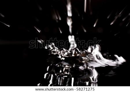 water splash isolated on black - stock photo