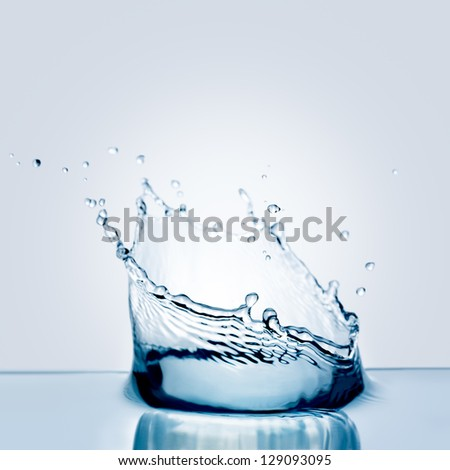 Water splash isolated on white. - stock photo
