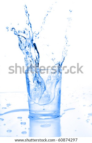 water splash on a glass - stock photo
