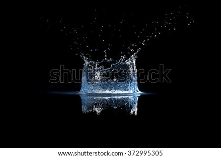 Water splash on black - stock photo