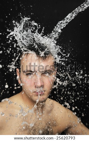 water splash on Man face - stock photo
