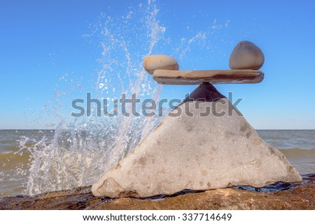 Water splash on pebbles stones - stock photo