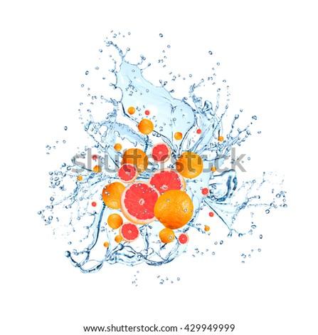 Water splash with fruits isolated on white backgroud. Fresh grapefruits - stock photo