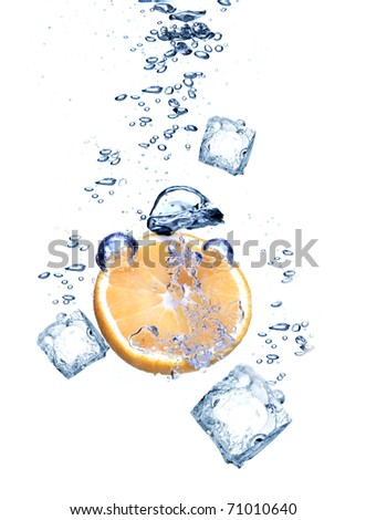 Water splash with Ice cubes and orange isolated on white - stock photo