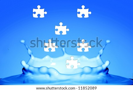 Water splash with puzzle effect - stock photo