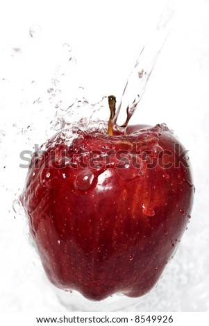 Water splashing down on an apple - stock photo