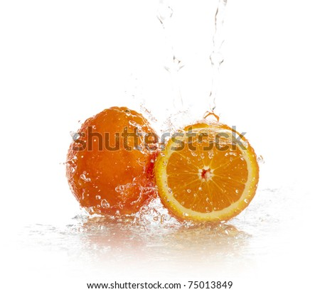Water splashing down on an orange with reflection - stock photo