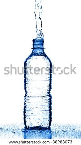 Water splashing from bottle isolated on white - stock photo
