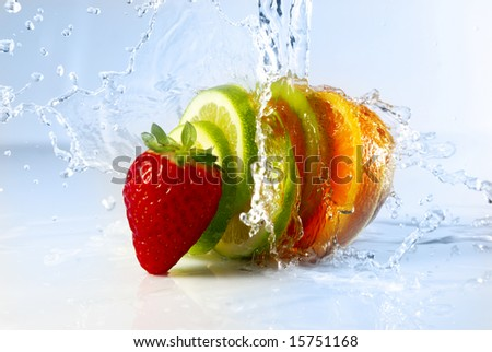 water splashing over sliced fruits - stock photo