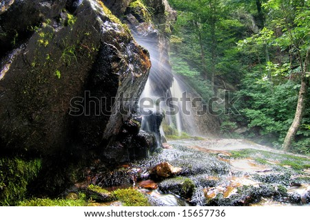 Water spray from the bottom of Apple Orchard Falls near Peaks of Otter, Virginia. - stock photo