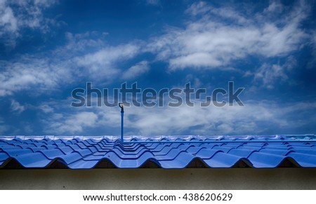 Water springer on roof  and sky with clouds