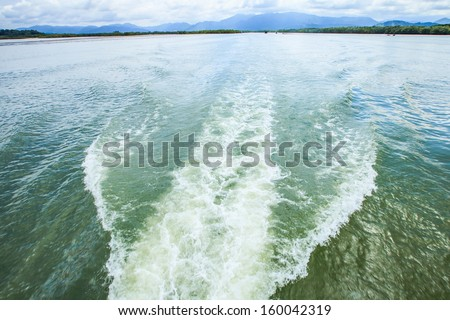 water steam after speed boat - stock photo