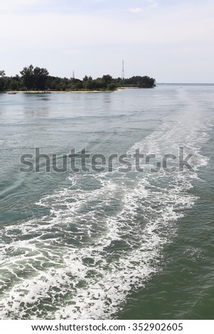 Water steam at sea after speed boat