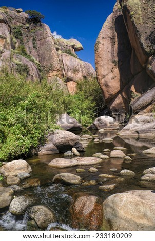 Water stream in narrow canyon in Cerro Uritorco in Argentina, South America - stock photo