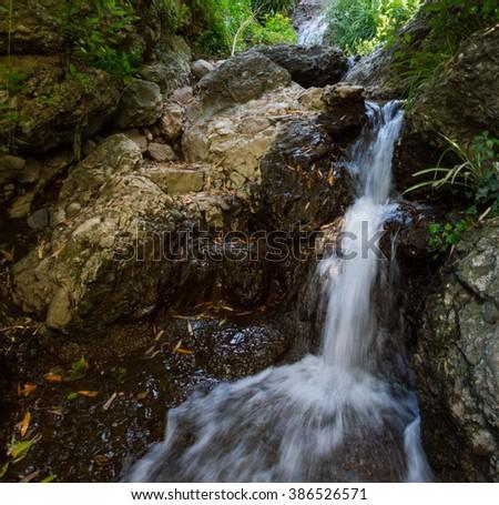 Water stream in San Fruttuoso - stock photo