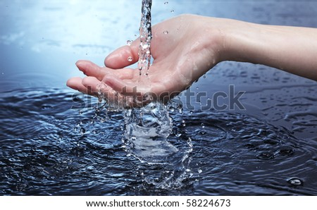 water stream on woman hand - stock photo