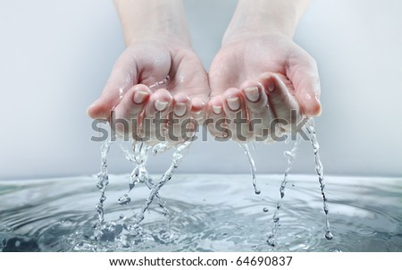water stream on woman hand