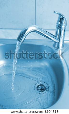 water stream shows good water-supply - stock photo