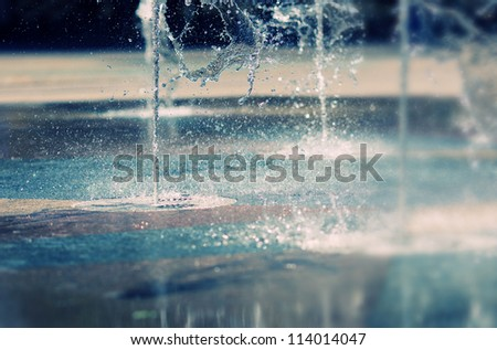 Water stream splashing on ground